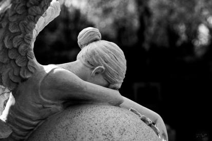 angel statue over ball .jpeg